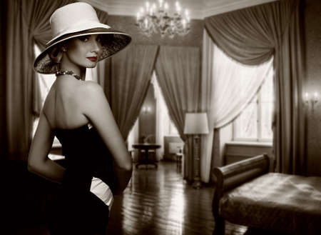 luxury background: Beautiful woman in hat in luxury room.