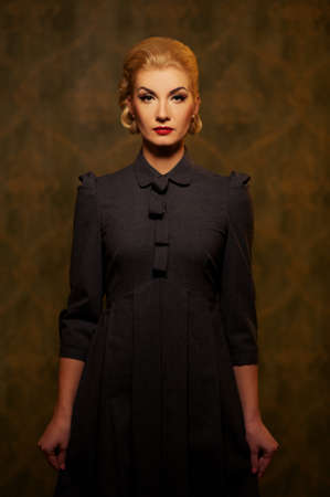 Retro woman in grey dress. photo