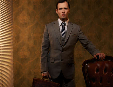 60s fashion: Retro man with a briefcase. Stock Photo