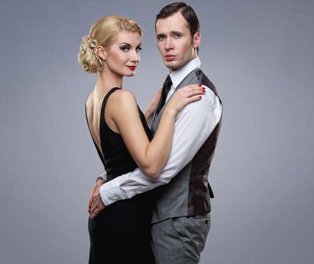 elegant business man: Retro couple on grey background.