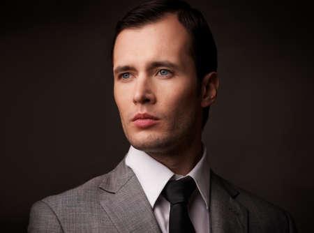 Man in grey suit portarit. Stock Photo - 12452221