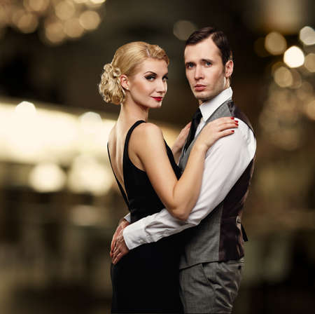 gangster background: Retro couple over blurred background. Stock Photo