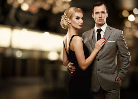 riches adult: Retro couple over blurred background. Stock Photo