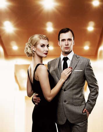 people in elevator: Retro couple in elevator.