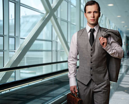 Man with a briefcase in an airport. Stock Photo - 12609174