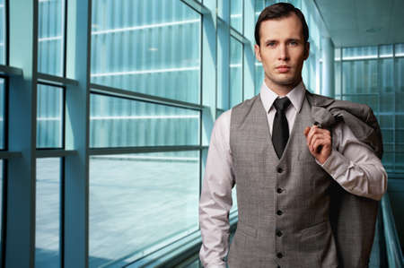man in suite: Man in grey suite in modern building. Stock Photo