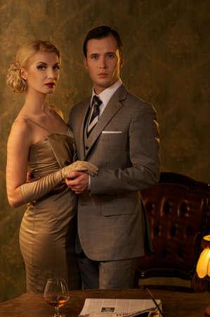 Couple in retro interior. Stock Photo - 12609158