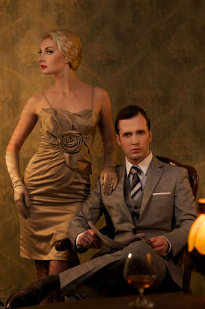 Retro couple sitting behind table. photo