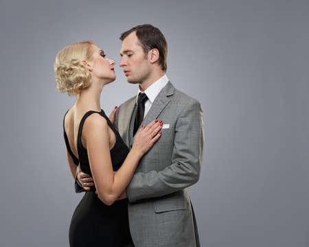 Retro couple on grey background. photo