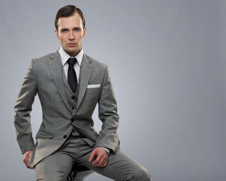 Businessman isolated on grey background. photo