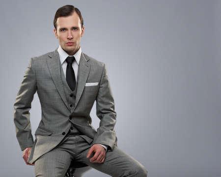 Businessman isolated on grey background. Stock Photo - 12609137