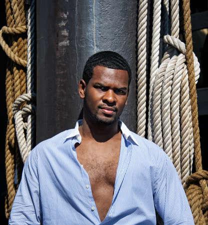 Handsome man against sailing tackles