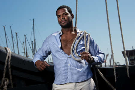 Handsome afro-american sailor against boats Stock Photo - 12609155