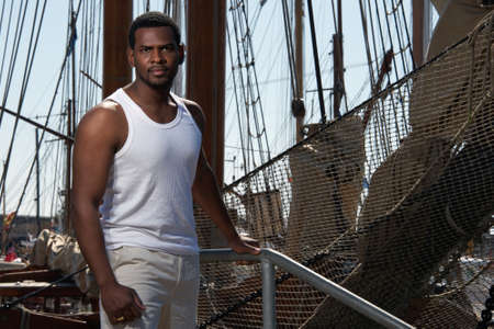 Handsome afro-american sailor against boats Stock Photo - 12609185