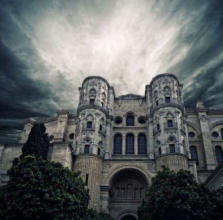incarnation: Stormy sky over The Cathedral of the Incarnation, Malaga, Spain. Stock Photo