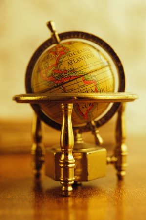 exploration: Vintage globe on a table. Stock Photo