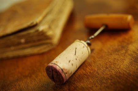 Corkscrew near a vintage book. photo