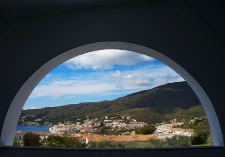 through the window: View over a town through window.