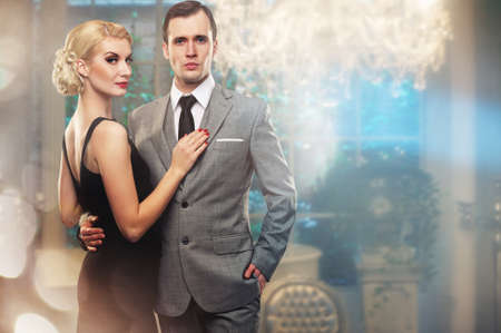 Retro couple in luxury inter. Stock Photo - 13231591