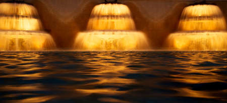 Three water cascades at night. photo