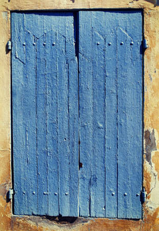 Old blue window shutters. photo