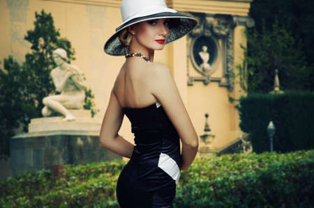 Beautiful woman in hat outdoors. Stock Photo - 13312779