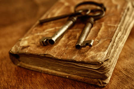 history: Old metal keys on vintage book