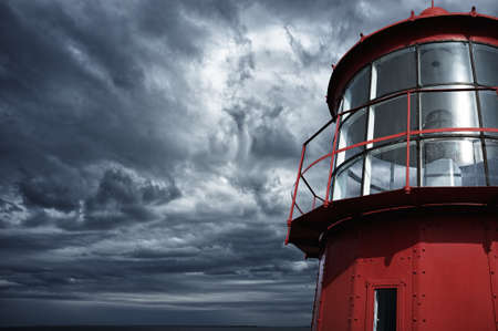 guiding: Lighthouse against  stormy sky.