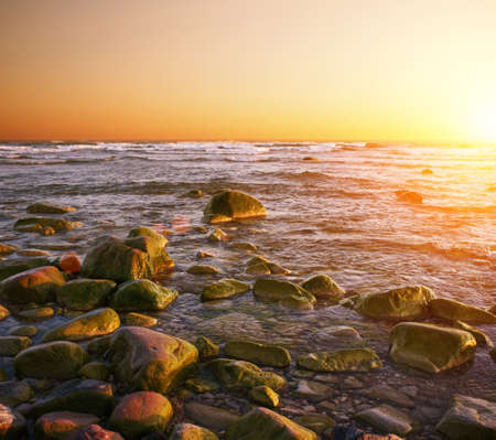 Rocky beach on a sunset. Stock Photo - 13679983