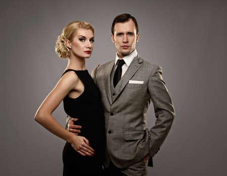 Retro couple on grey background. Stock Photo - 13667982