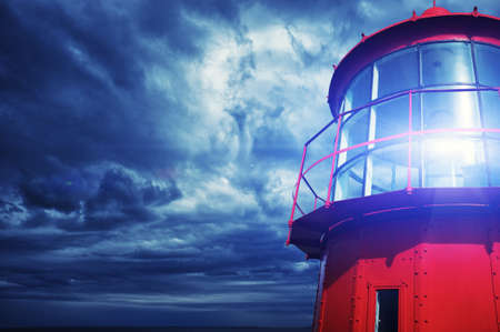 to warn: Lighthouse against  stormy sky.