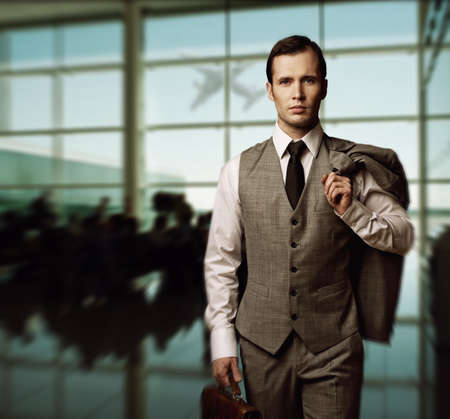 Man with a briefcase in an airport photo