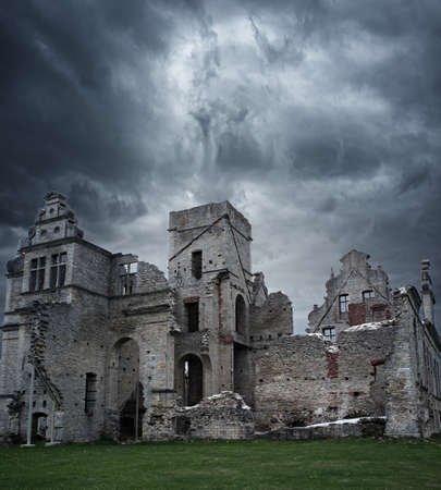 Stormy sky over ruins of manor house photo