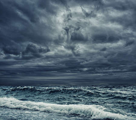 Stormy sky over an ocean photo