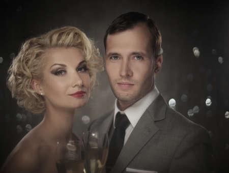 Retro couple with glasses of champagne portrait photo