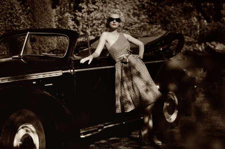 antique woman: Mujer al aire libre, cerca de un coche retro