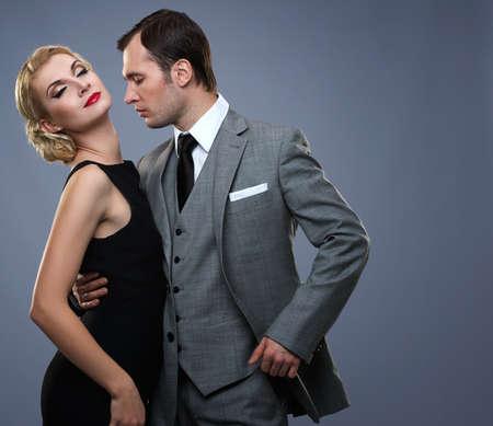 Retro couple isolated on grey background photo