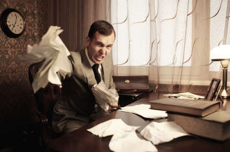 malice: Angry businessman rumples a documents Stock Photo