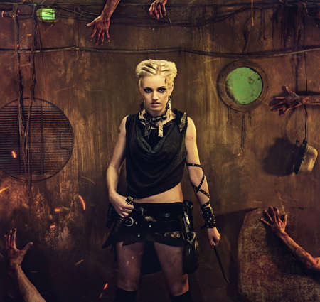 Woman in a bunker with zombie hands around her Stock Photo - 14082193