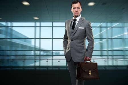 Businessman inside modern building photo