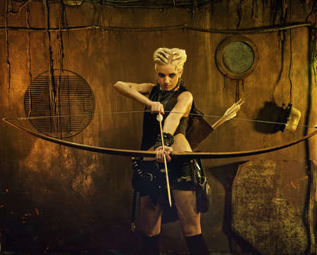 post apocalypse: Woman with a bow in a bunker