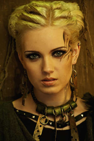 toxicity: Blond girl with a ethnic necklace portrait
