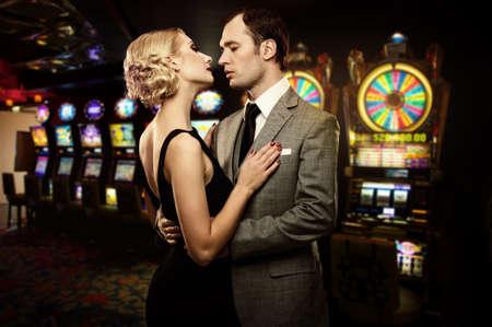slot machines: Retro couple against slot machines Stock Photo