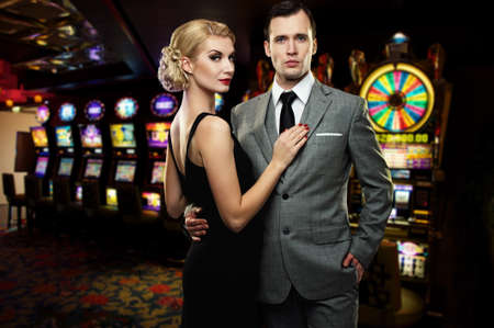 casinos: Retro couple against slot machines Stock Photo