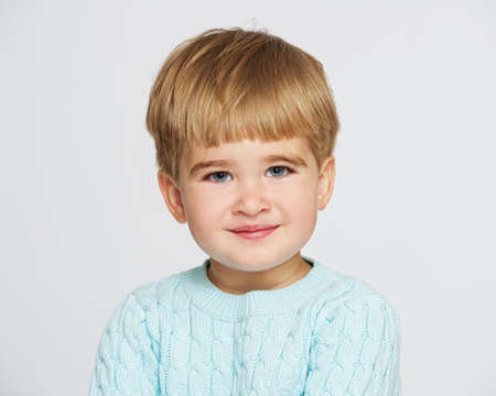 Smiling baby boy in blue pullover portrait Stock Photo - 14082202