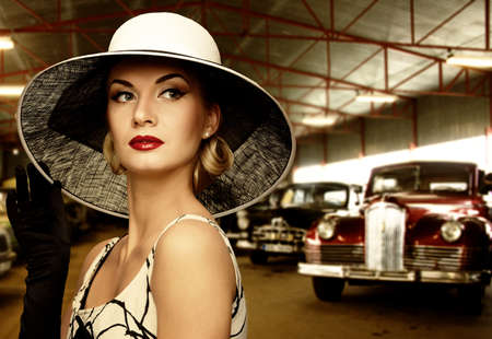 Woman in hat in retro garage photo