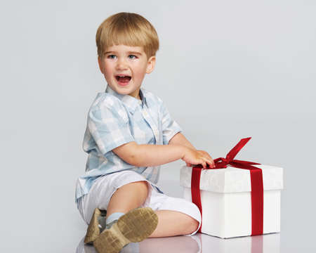 Happy baby boy with a gift box Stock Photo - 14624287