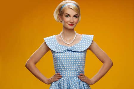 Beautiful smiling woman in blue dress Stock Photo - 14624325