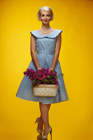 Lovely woman in a blue dress with a flowers photo