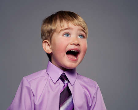 Funny baby boy in purple shirt photo